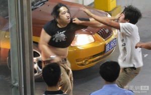 things got physical at a Beijing train station when one man jumped the taxi queue