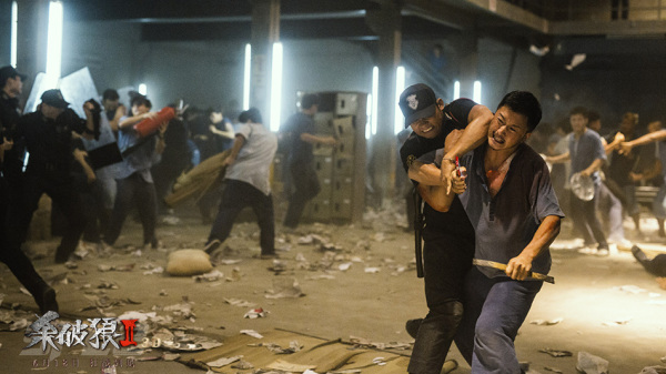 wu jing and tony jaa face off in a prison break out scene