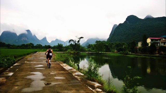 It that my younger sister or my cousin cycling off into the hills outside of Guilin?